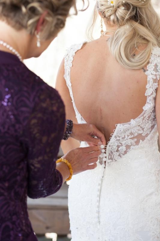 Final buttons on wedding dress