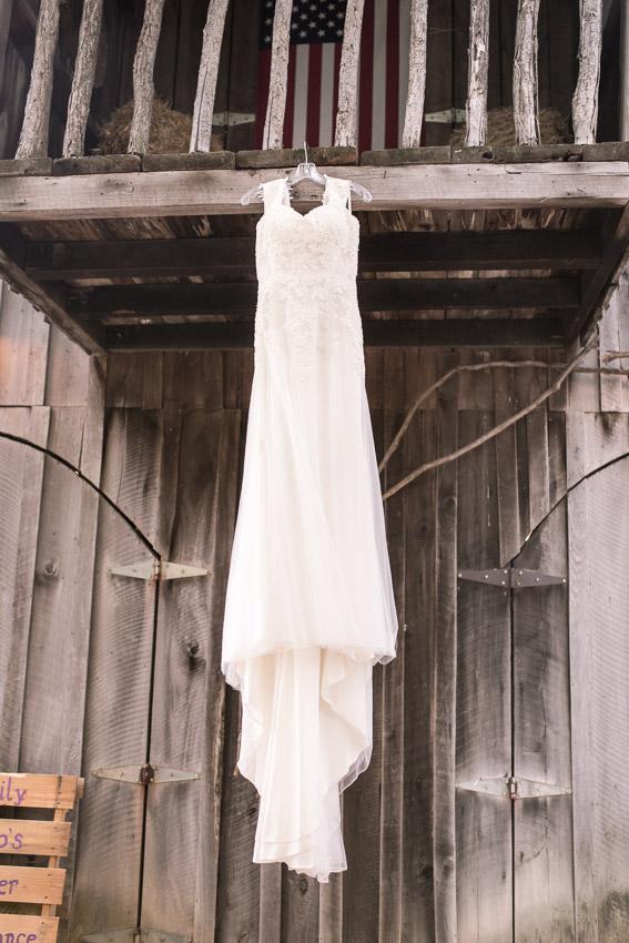 wedding-dress-at-smiley-hollow-hanging-on-barn.jpg