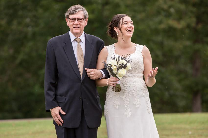bride-laughing-at-rain-smiley-hollow-wedding-nashville.jpg
