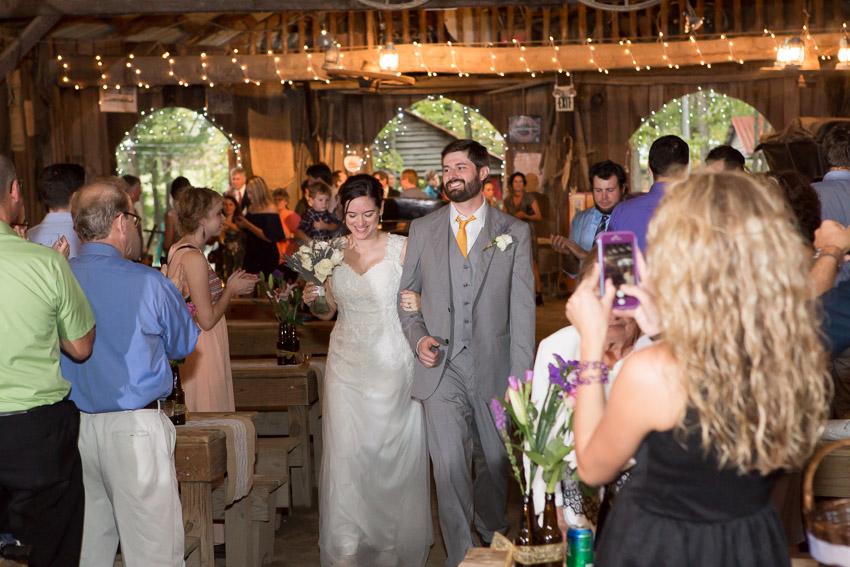 newlyweds-entering-reception-smiley-hollow.jpg