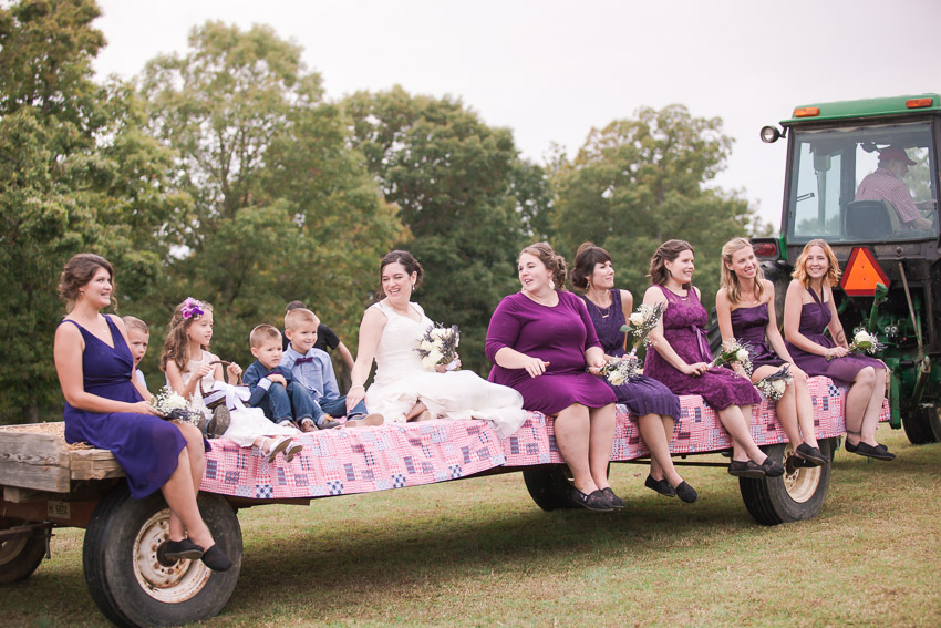 Nashville-wedding-photographer-tractor-bringing-in-wedding-party.jpg