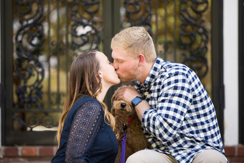 couple-kissing-and-covering-dogs-eyes.jpg