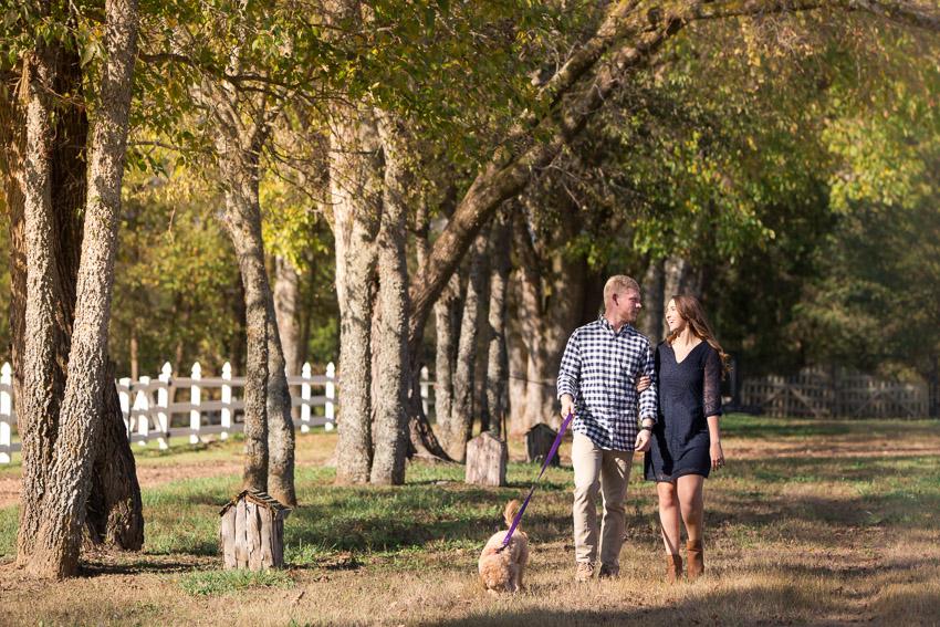 engaged-couple-walking-dog.jpg