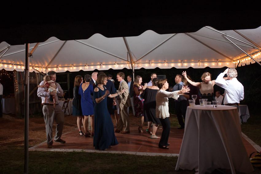 guests-dancing-under-tent-outdoor-nashville-wedding.jpg