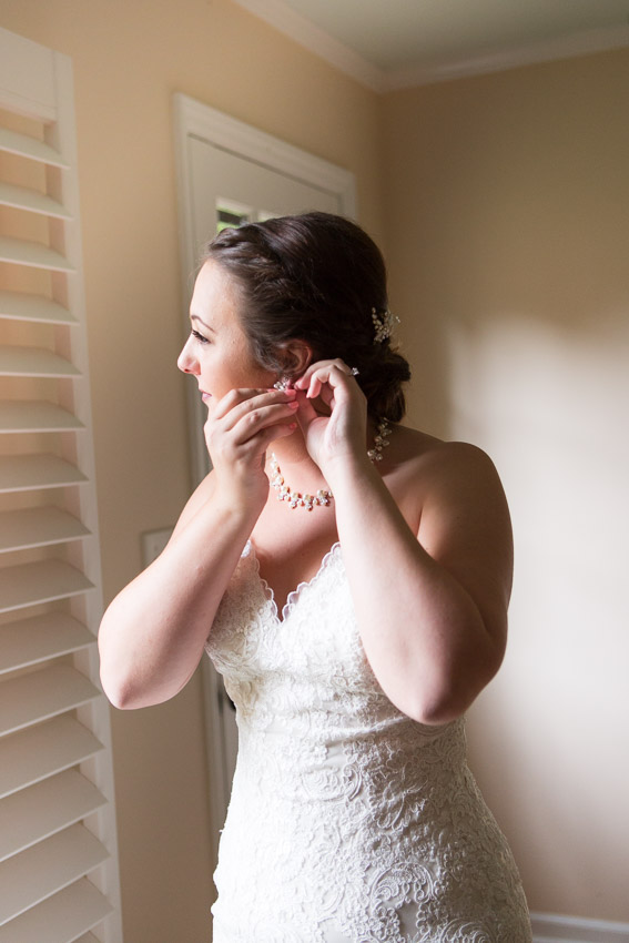 bride-putting-on-earrings.jpg