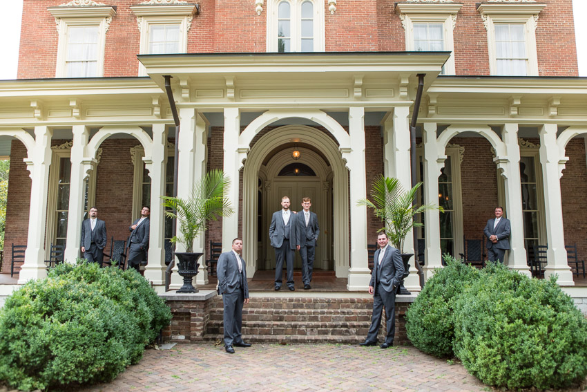 groom-on-steps-oaklands-mansion.jpg