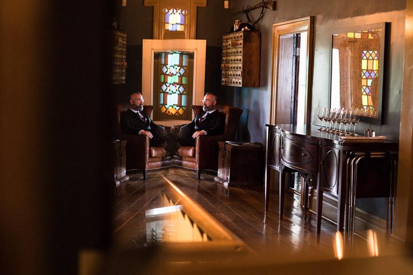 groom-in-chair-wedding-day-homestead-manor.jpg