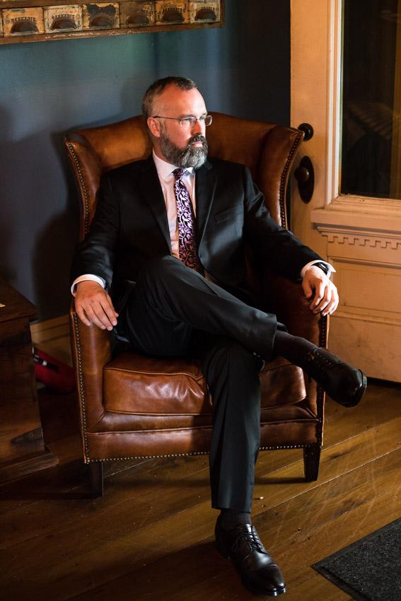 groom-in-leather-chair.jpg