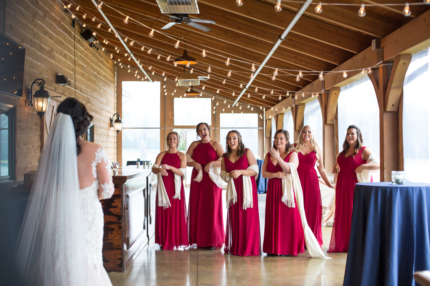 brides-first-look-with-bridesmaids-barn-at-sycamore-farms.jpg