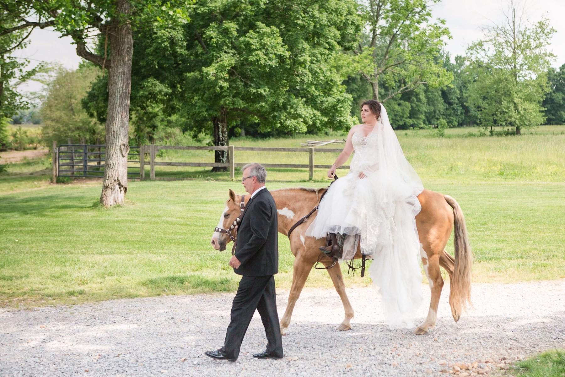bride-riding-horse-to-alter-cactus-creek-barn.jpg