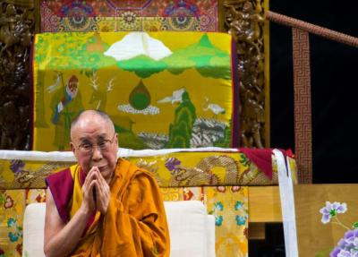 "The Dalai Lama prays with the crowd during Thursday's morning session, ""Eight Verses of Training the Mind,"" in the Coors Event Center at the University of Colorado at Boulder. (  Autumn Parry / Staff Photographer  )"