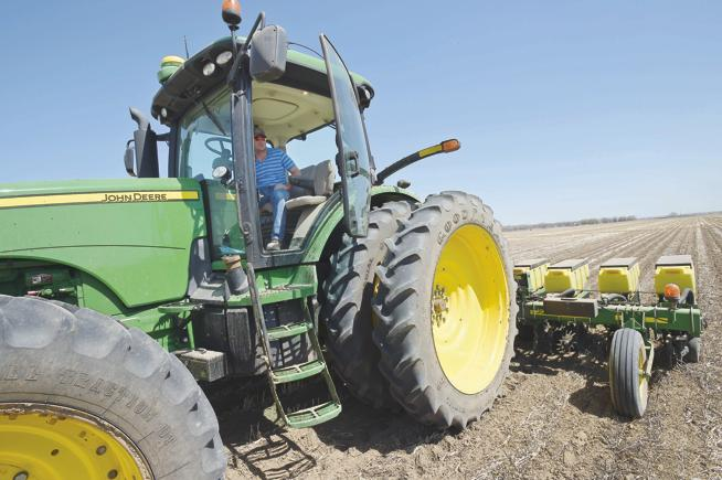 Scott Schlagel plants sugar beets in a 110-acre field south of Longmont Wednesday. - (Lewis Geyer / For the Camera)