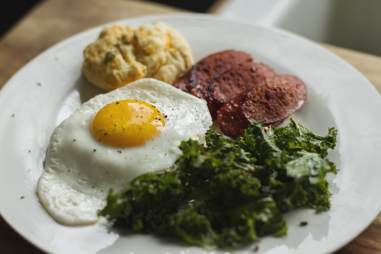 Starting off the day right.  Cheese biscuits, farmer sausage, garlic kale and a sunny egg.