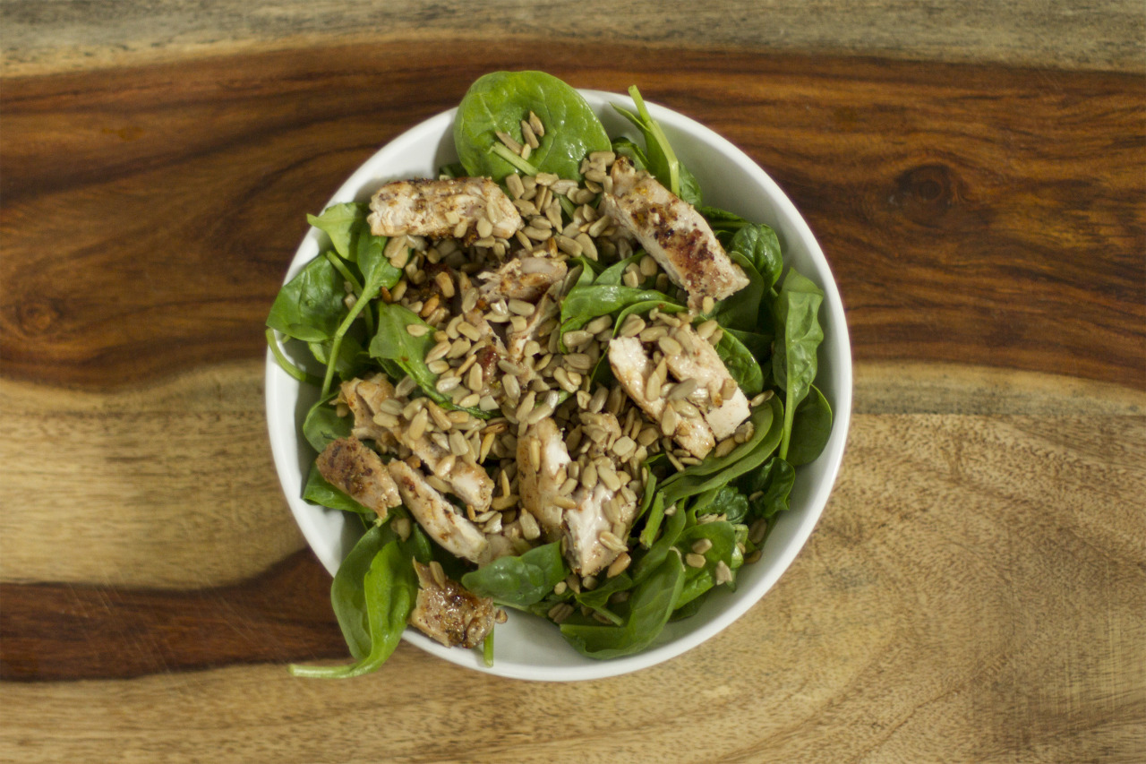 Lunch time salad! Grilled chicken, sunflower seeds, and spinach.