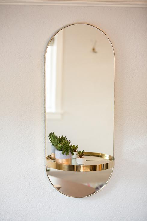 gold oval mirror.jpg