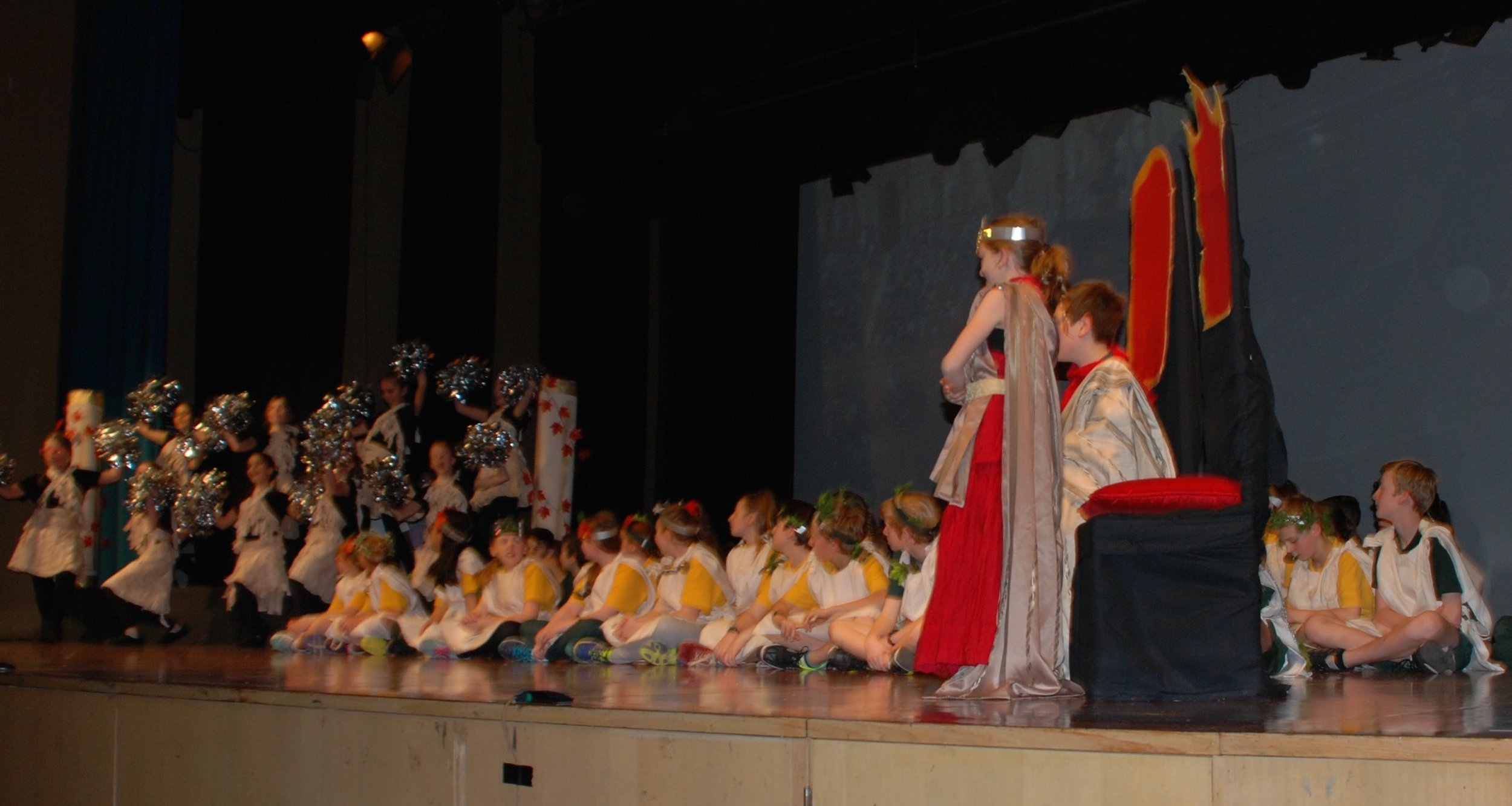Emperor and Emporess receive a cheer from the roman audience.