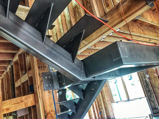Been a while since we worked on this stair design, but great to see this beast get installed! . Can't wait to see the treads put in place!! . . . #stairs #staircase #steelstairs #industrialmodern #pnwmodern #modernhome #steelandwood