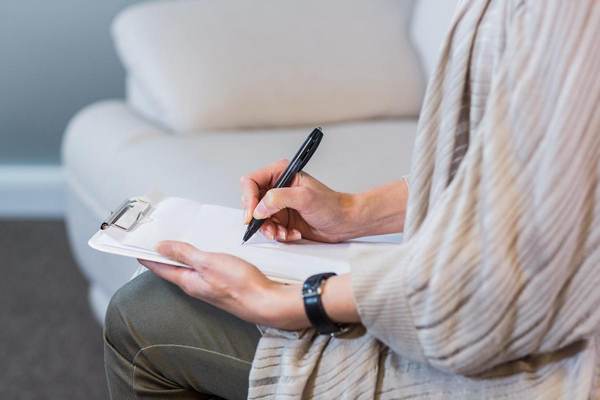 Psychologist taking notes