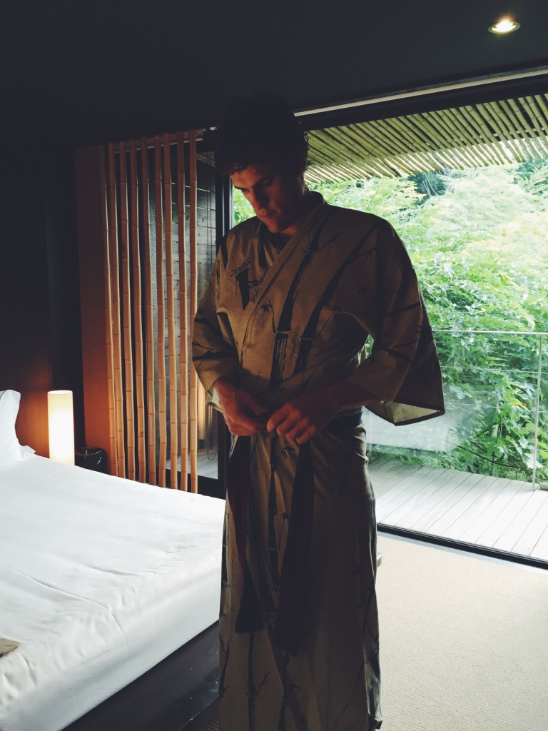 Donning a yukata (left side always folds over right side!).