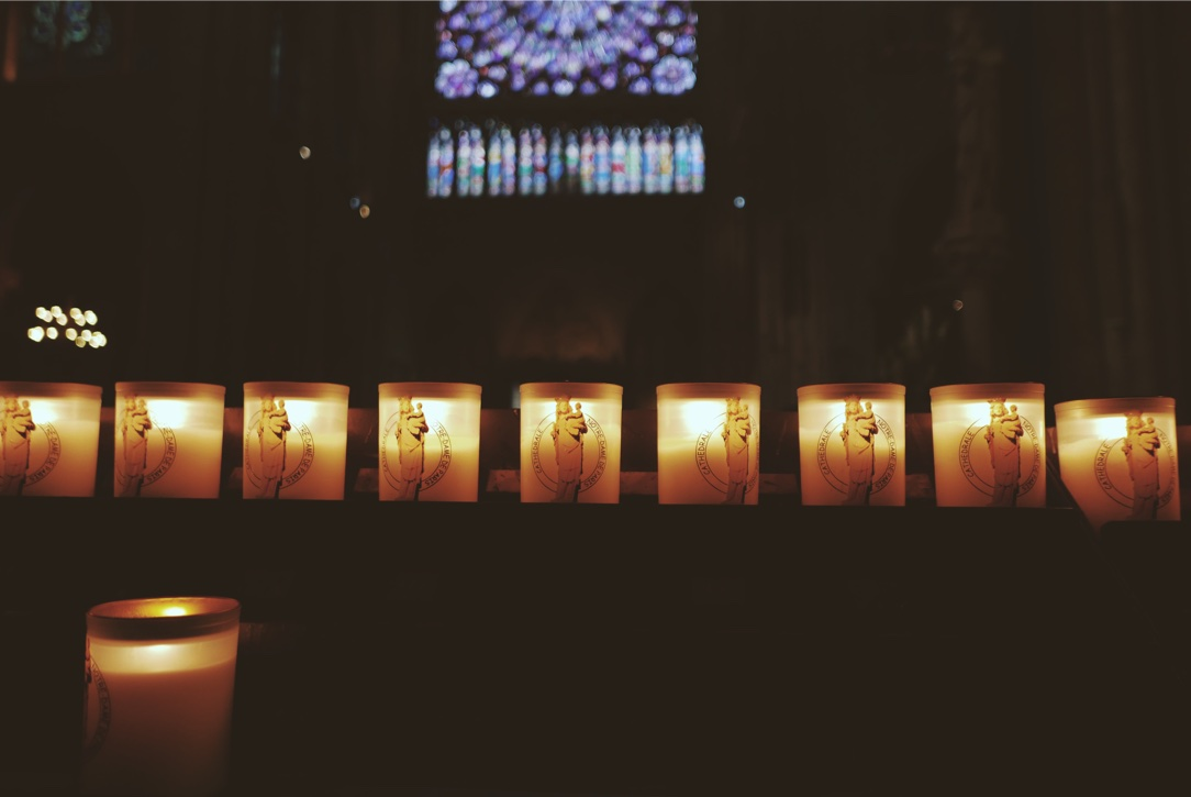 Candles lit by visitors inside Notre Dame.