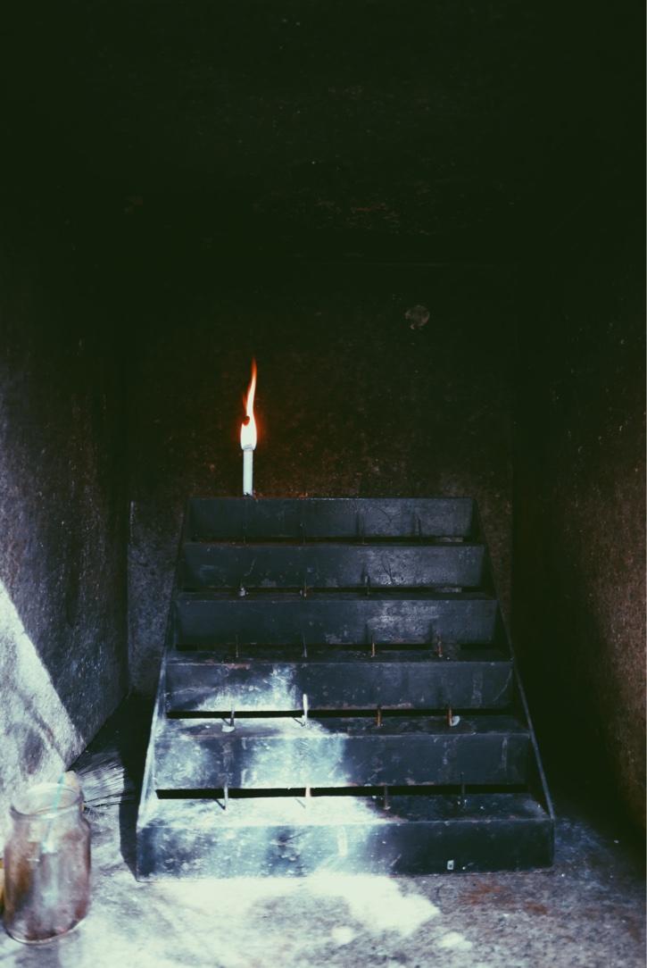 A lone prayer candle.