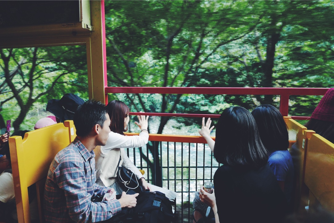 Waving goodbye from the Sagano 'Romantic' Train.