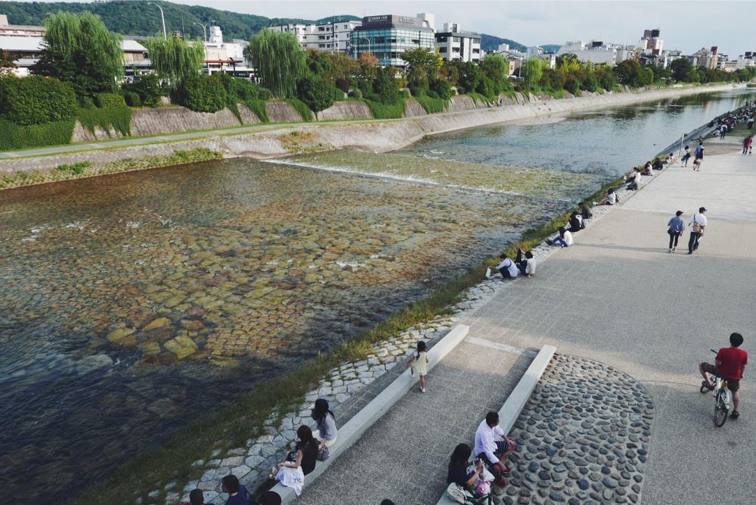 Loungers on the banks of the Kamo-gawa.