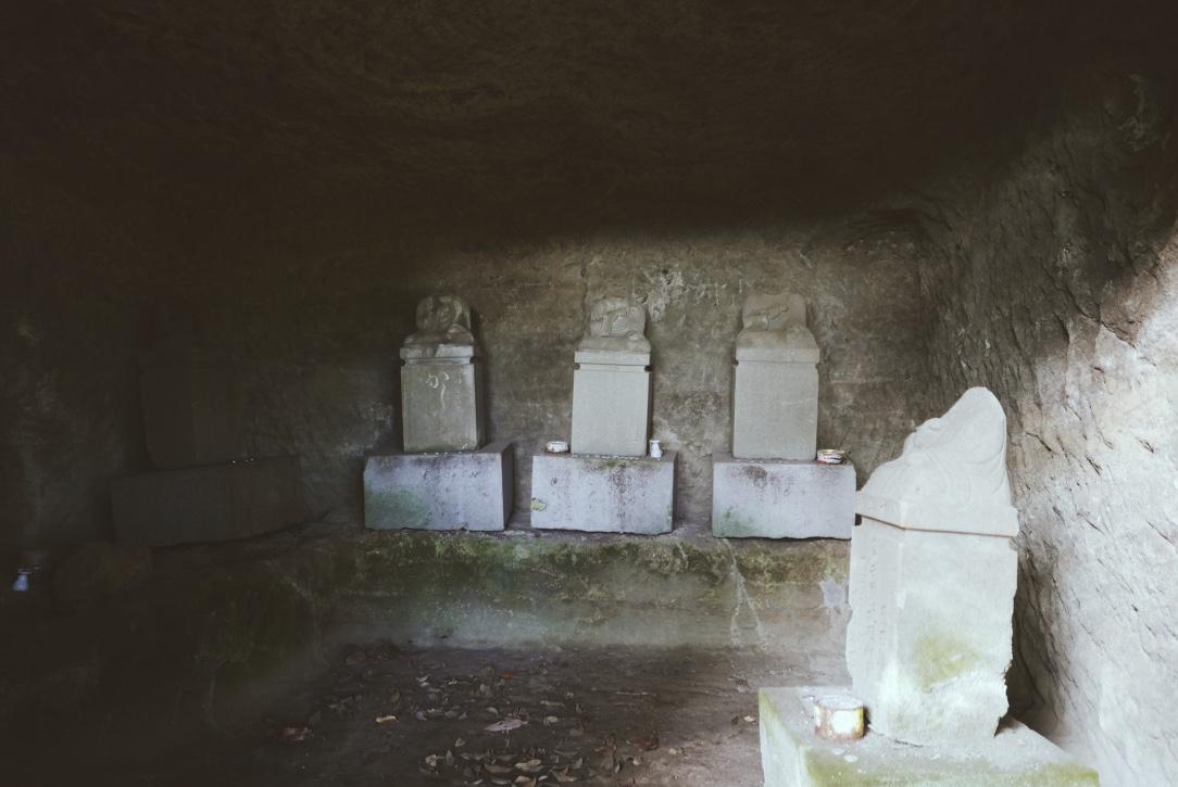 Peeking inside the tomb caves.