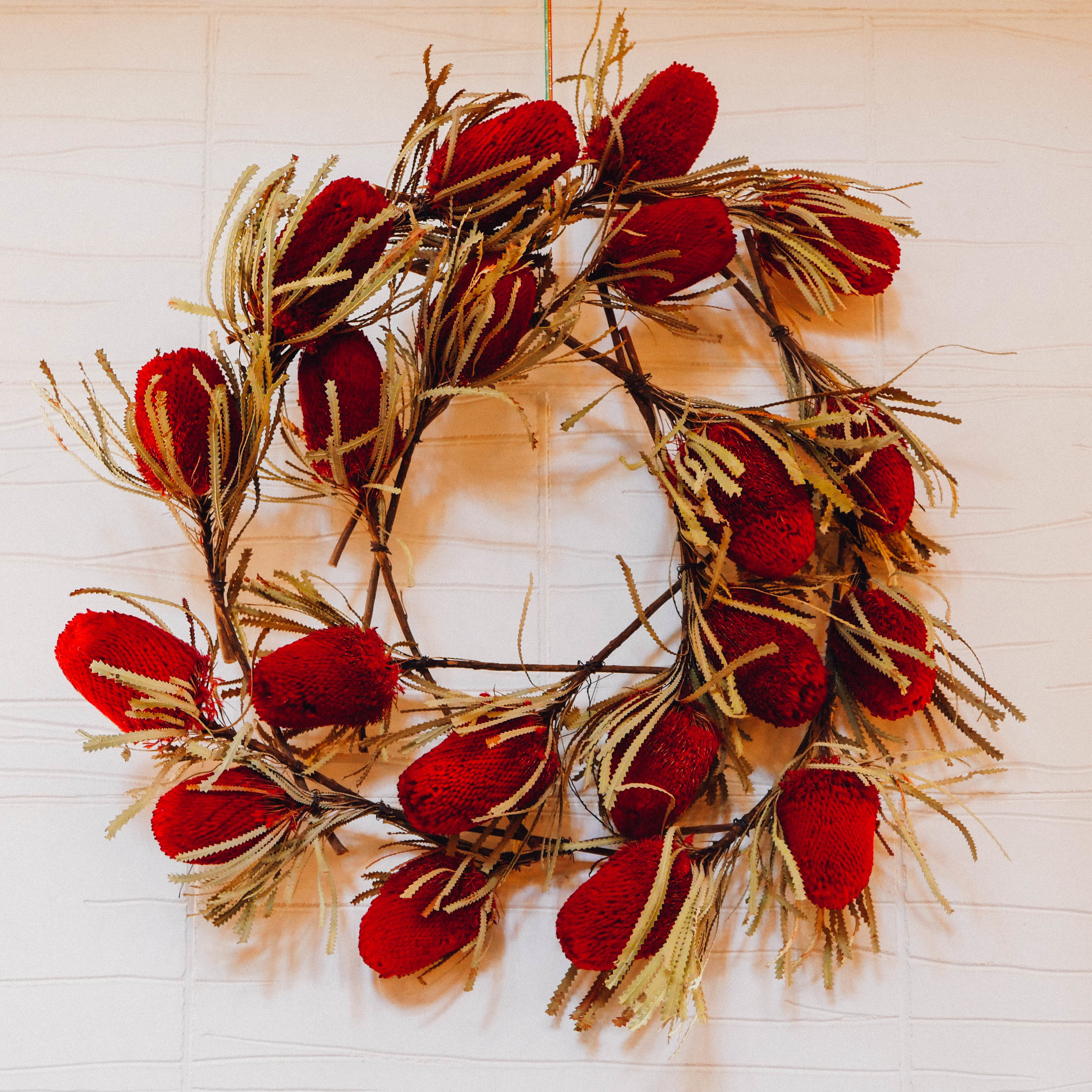 A Christmas wreath crafted from proteas in the home decorated for Australia.
