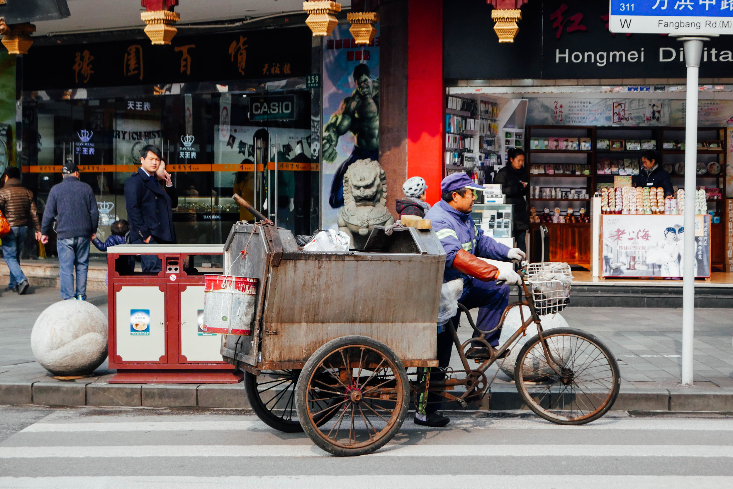 Shanghai's garbage collectors are - of course - on bikes.