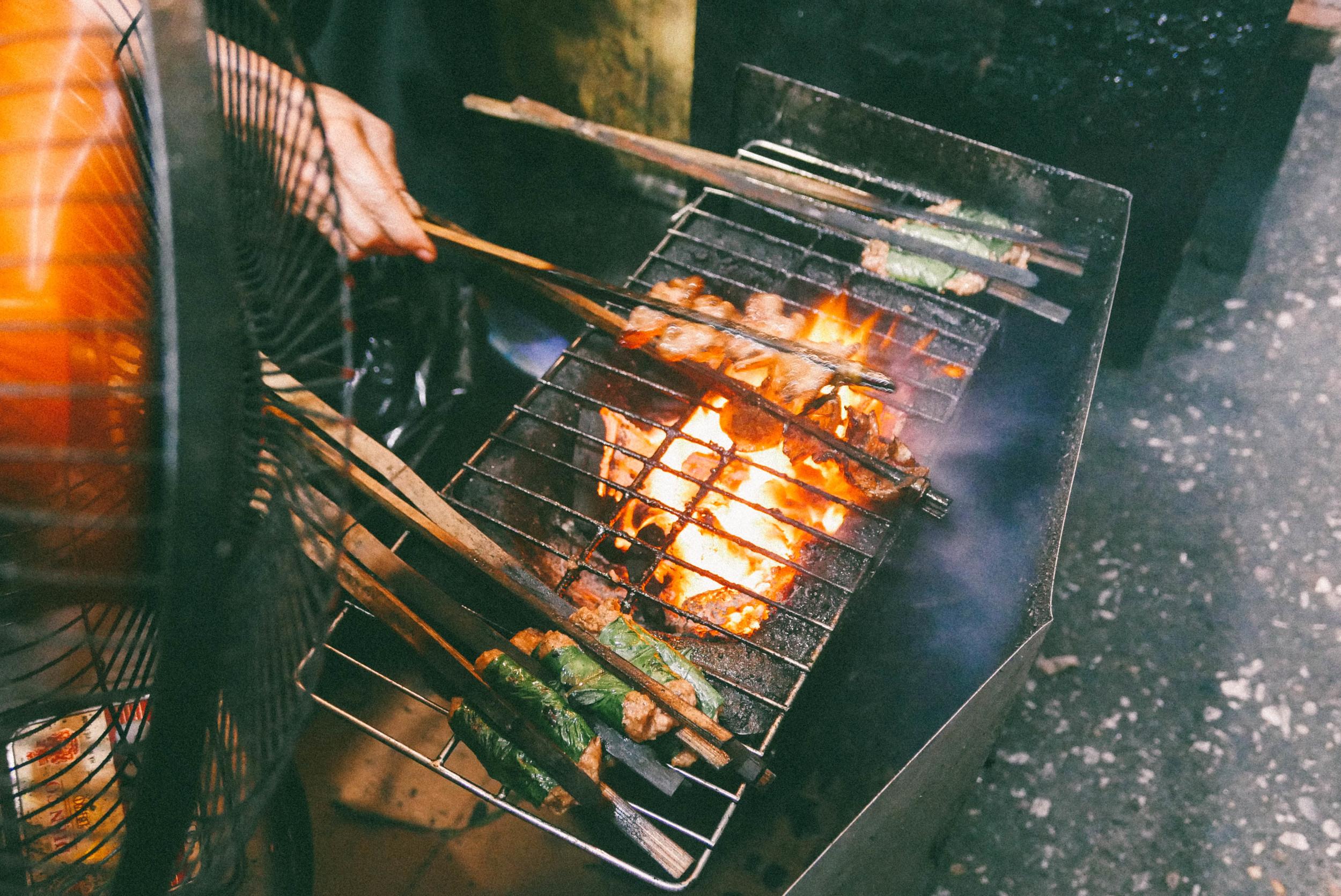 Grilling the pork patties for bun cha.