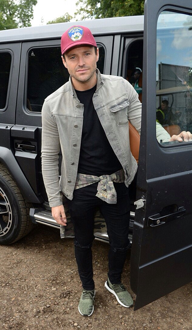 TOWIES Mark Wright, casually wearing his Camoflauge sweatshirt around his waist.