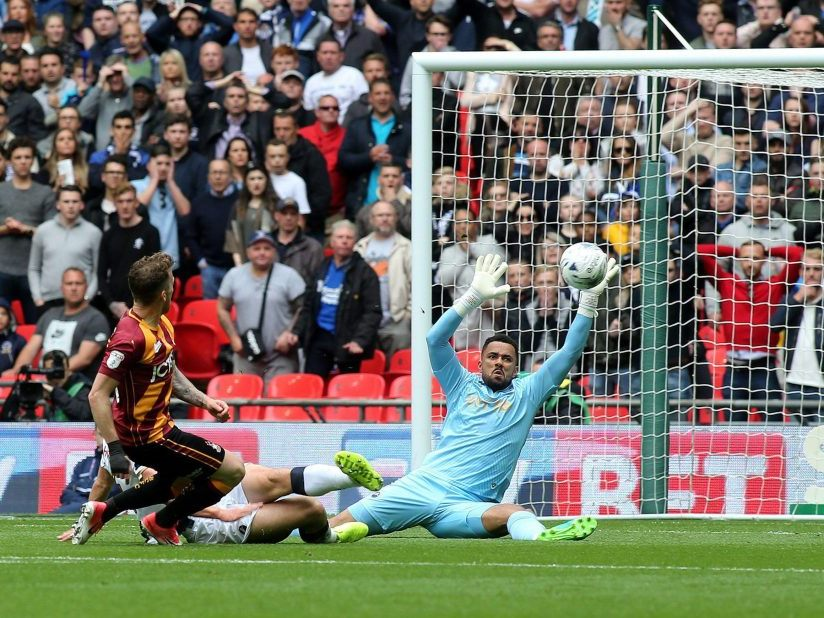 Millwall Keeper Jordan Archer pulls off a spectacular save to deny Bradford City's Billy Clarke from opening the scoring