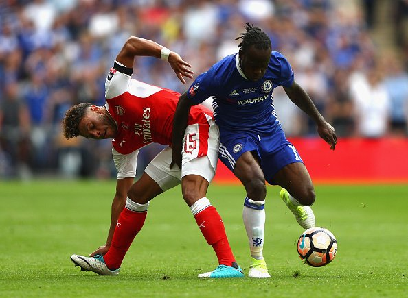 Victor Moses who was dismissed battles with Alex Oxlaide Chamberlain