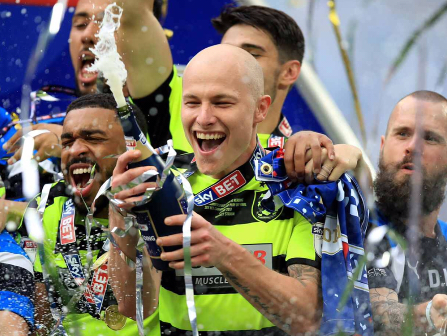 Manchester City Loanee Midfielder Aaron Mooy lifts trophy