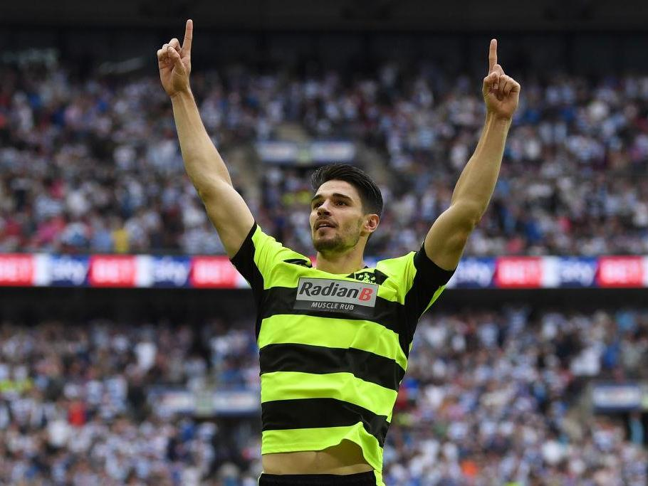 Huddersfield Defender Schindler celebrates his penalty decider