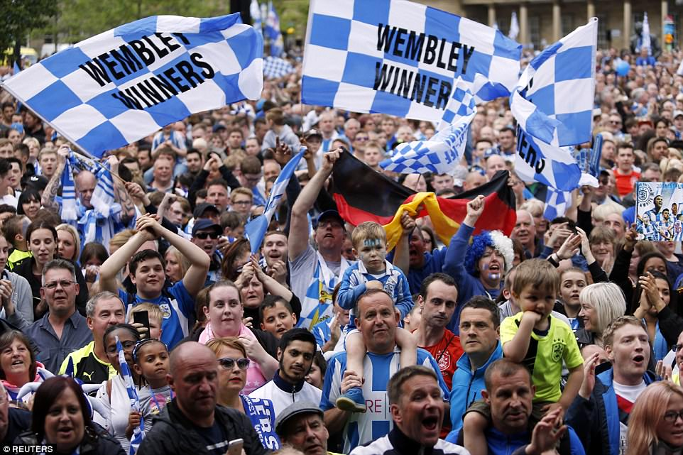 Huddersfield Town fans gather outside Town Hall to welcome their heroes