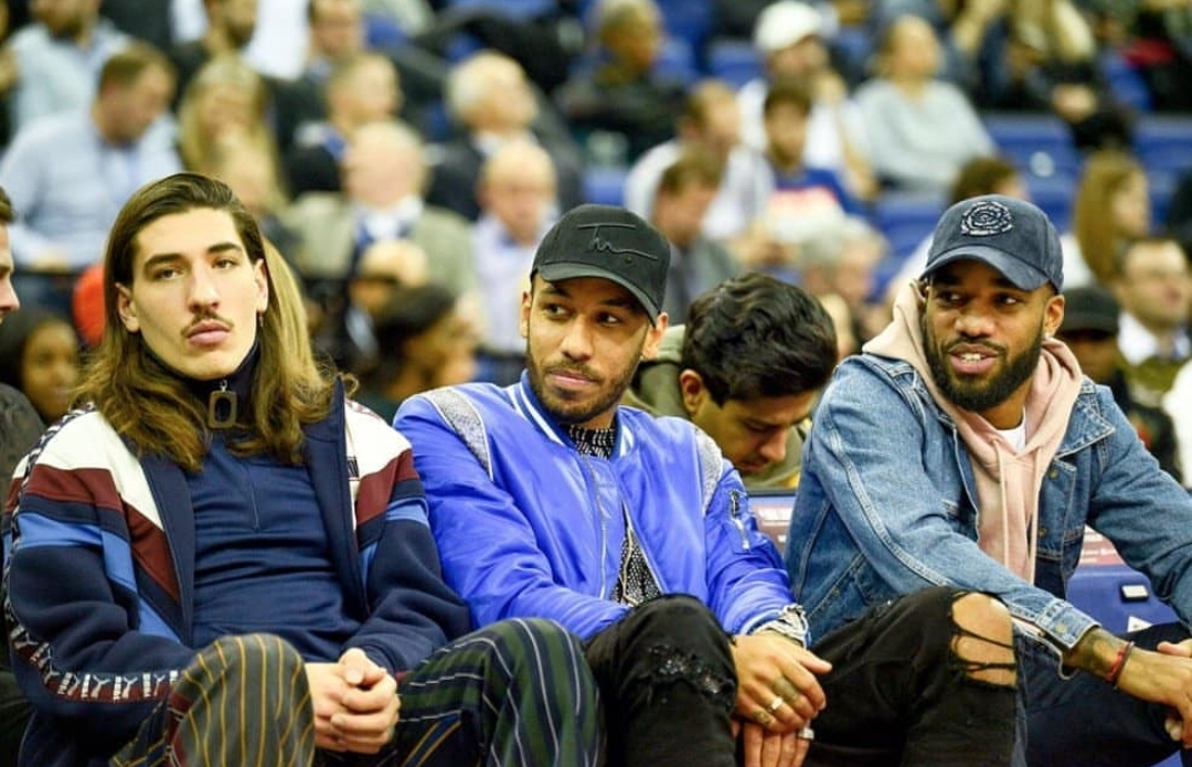 Arsenal FC players Hector Bellerin, Pierre Emerick Abameyang and Alexandre Lacazette court side at the NBA 2019