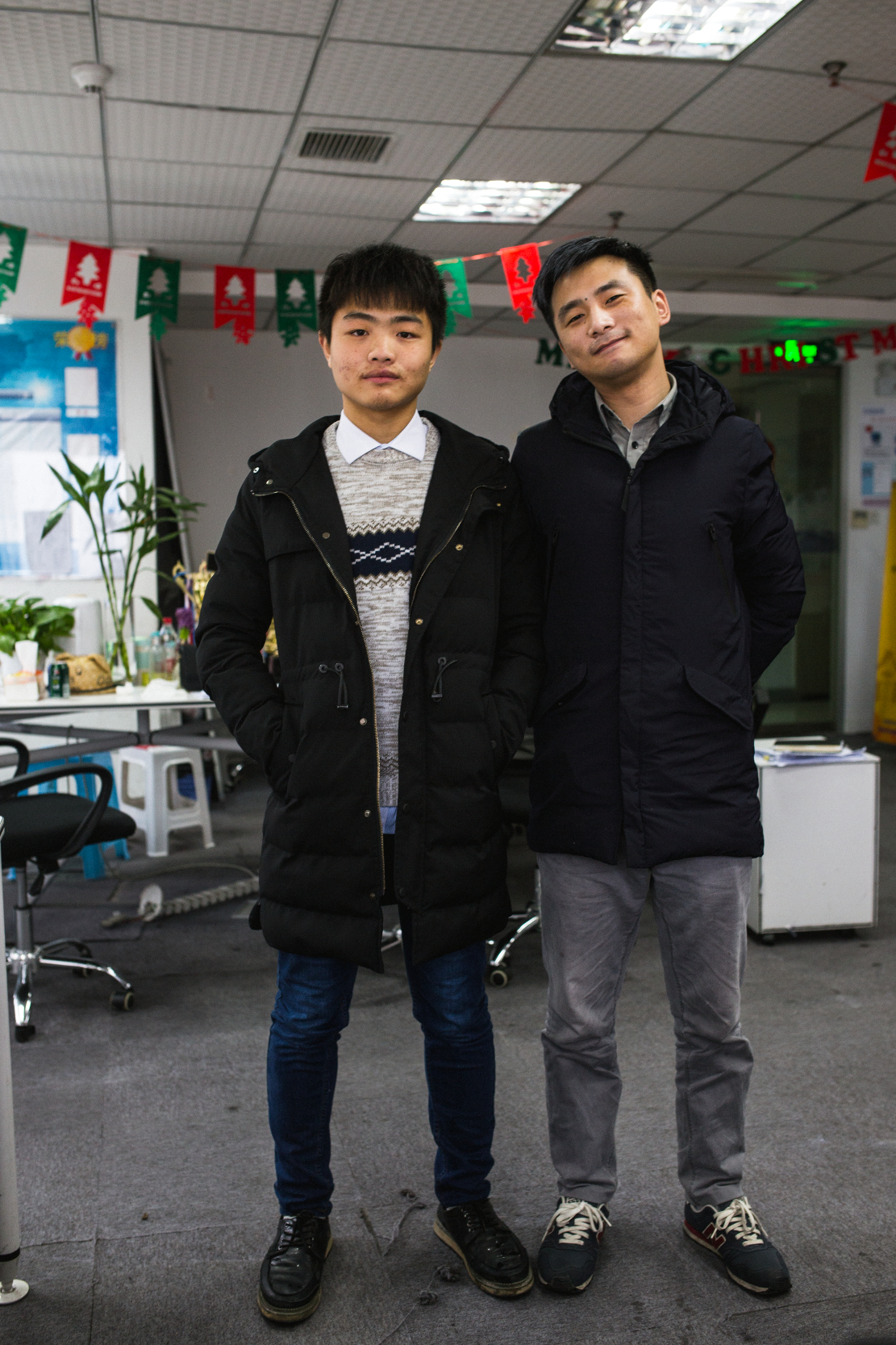 """I worked in a few different factories before I came here, but I'm much happier here. Back there each day was routine. Here I can use my skills. The money's better as well, the harder I work the more I can earn.""  Bai Jintao (left) Chongqing February 2017"