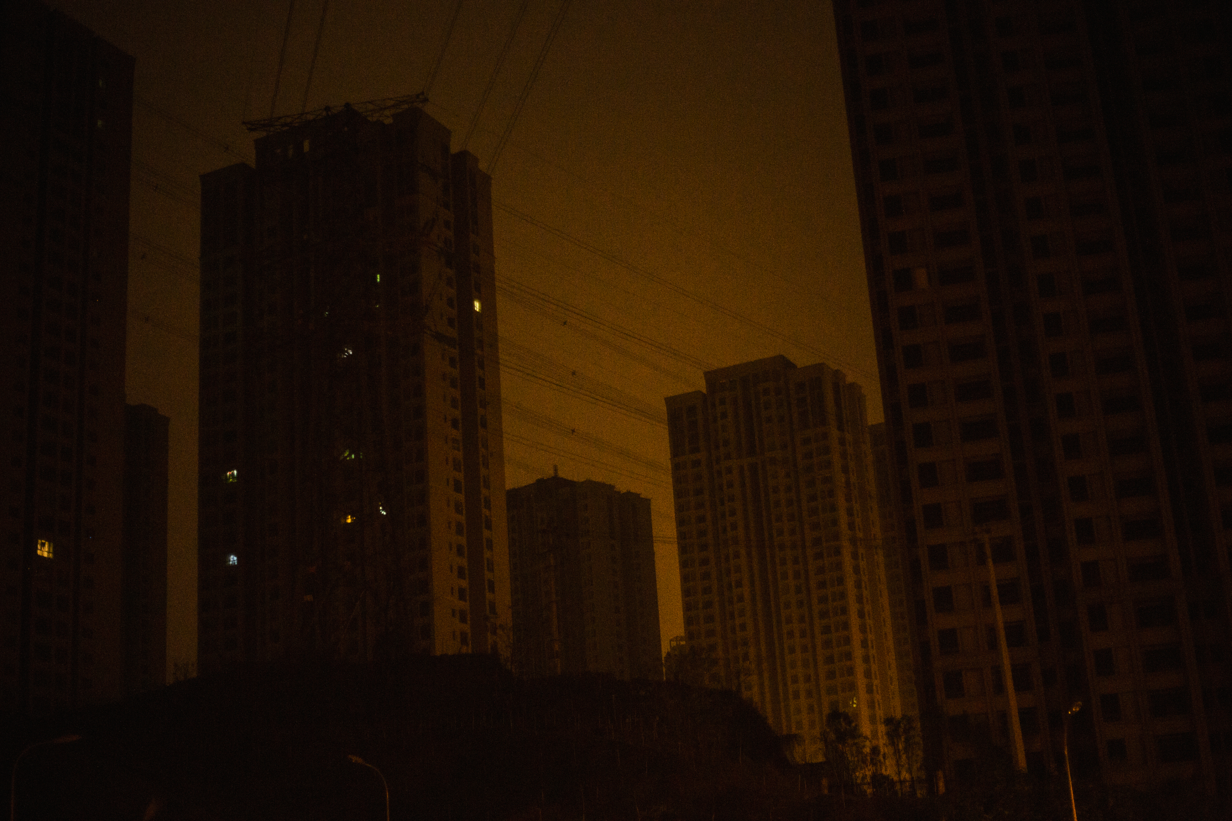 The city is expanding rapidly in a real estate boom that is rapidly changing how and where Chinese society makes its home. Many of the new buildings will be purchased but remain uninhabited for several years.  Chongqing, January 2017