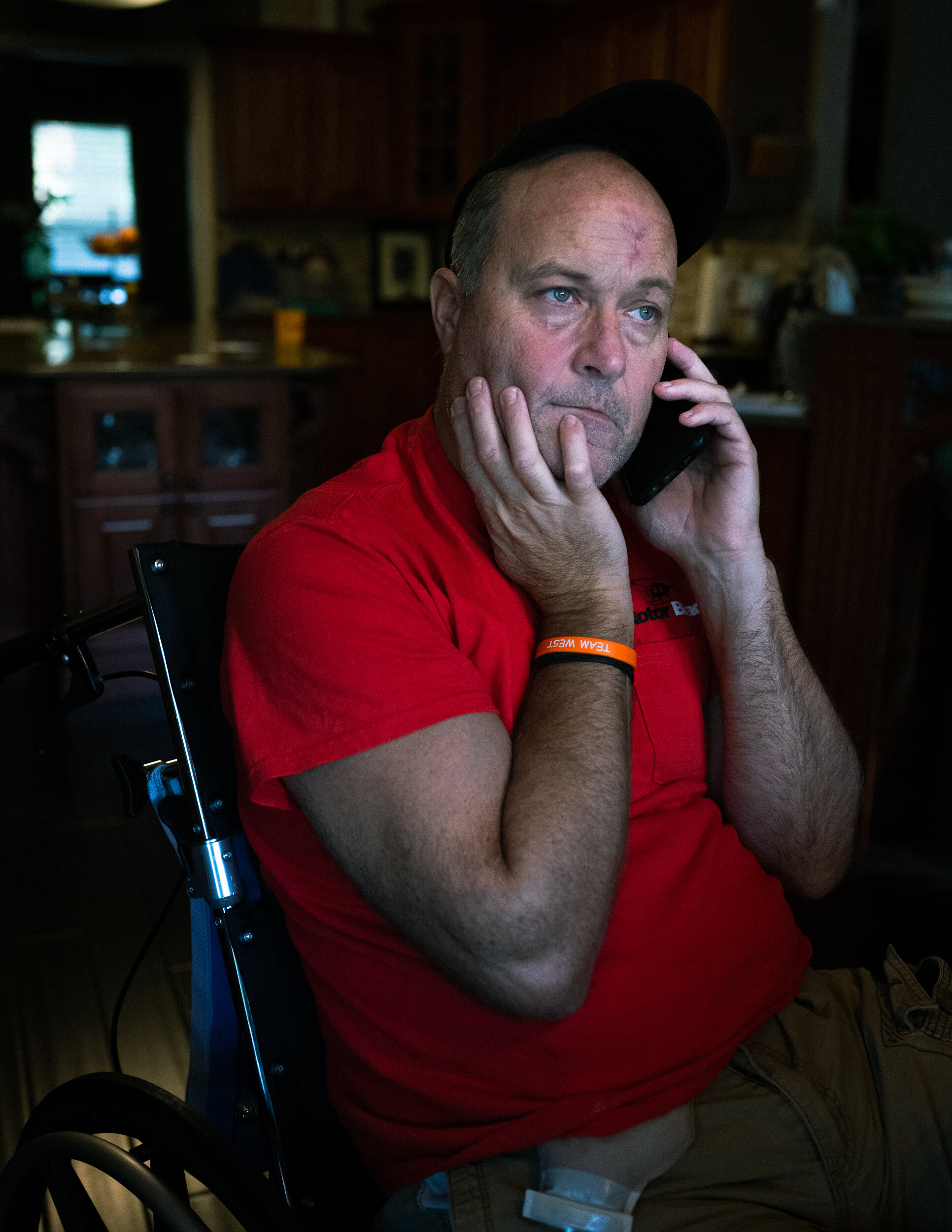 "Previously a highly active member of his community, Clark Greis now works from home. ""Before this, I used to go at 103 miles an hour, but after it happened, I have to go at minus three,"" he said of his injury."