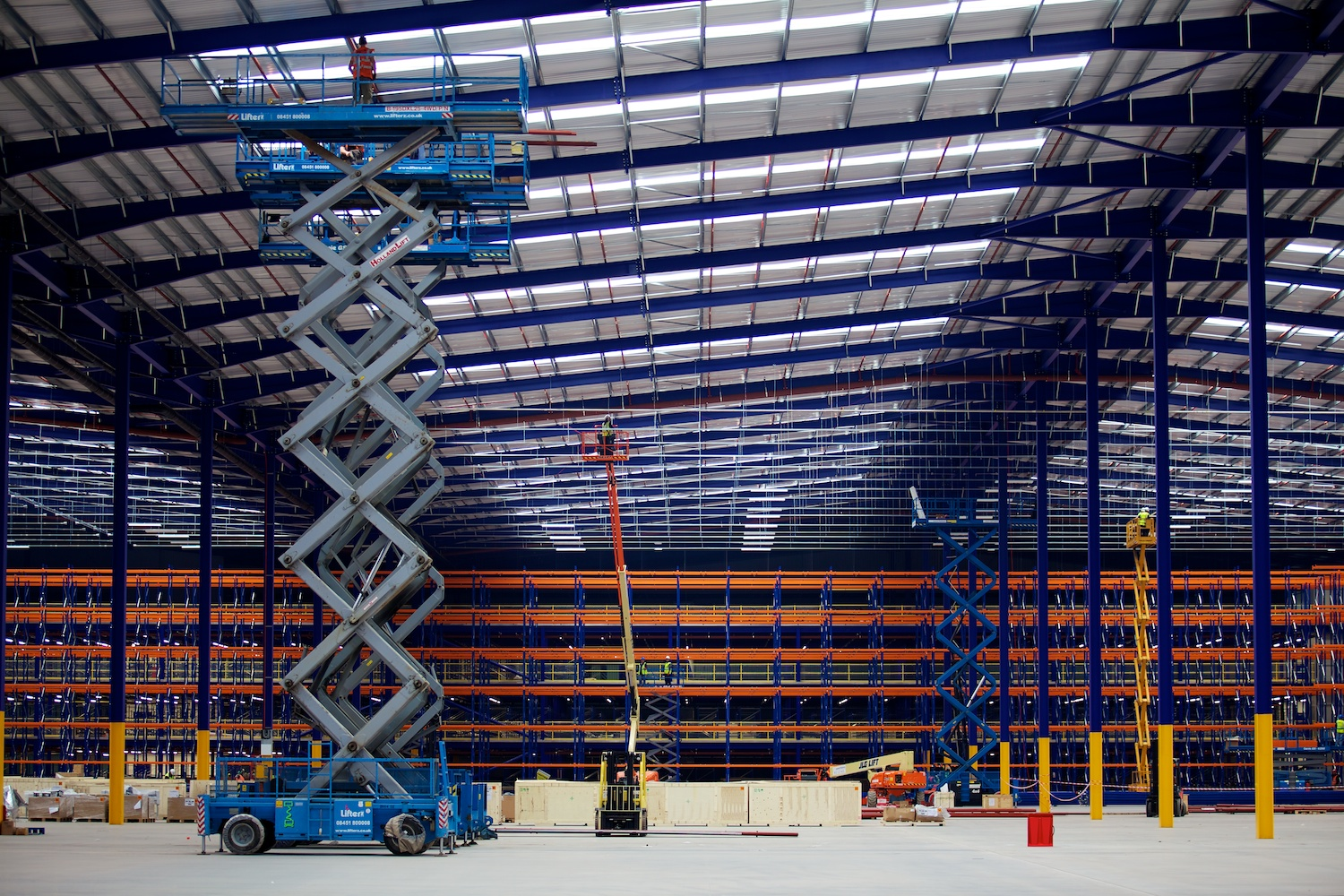 MEWP installing racking in logistics centre