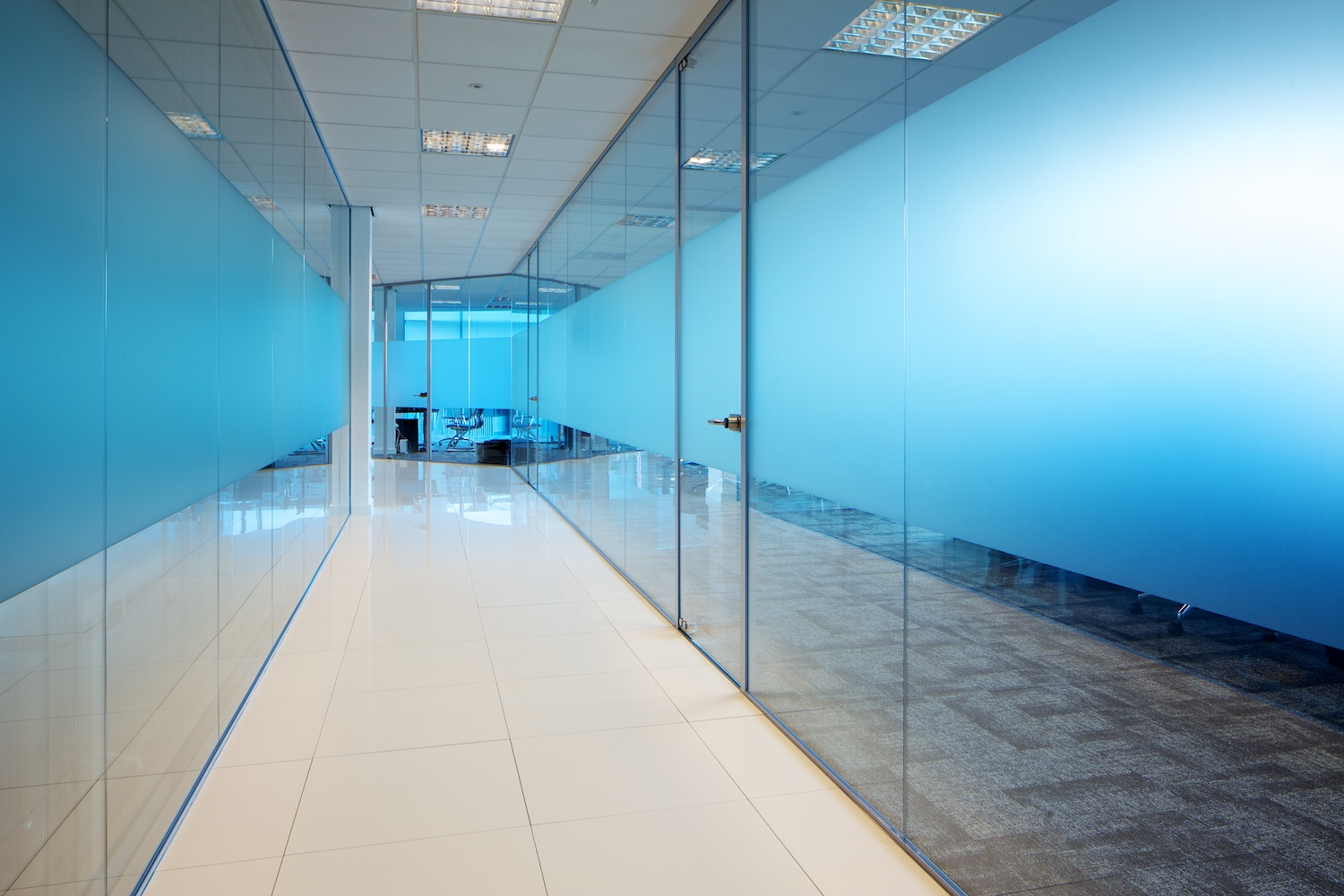 commercial office interior hallway with glass doors