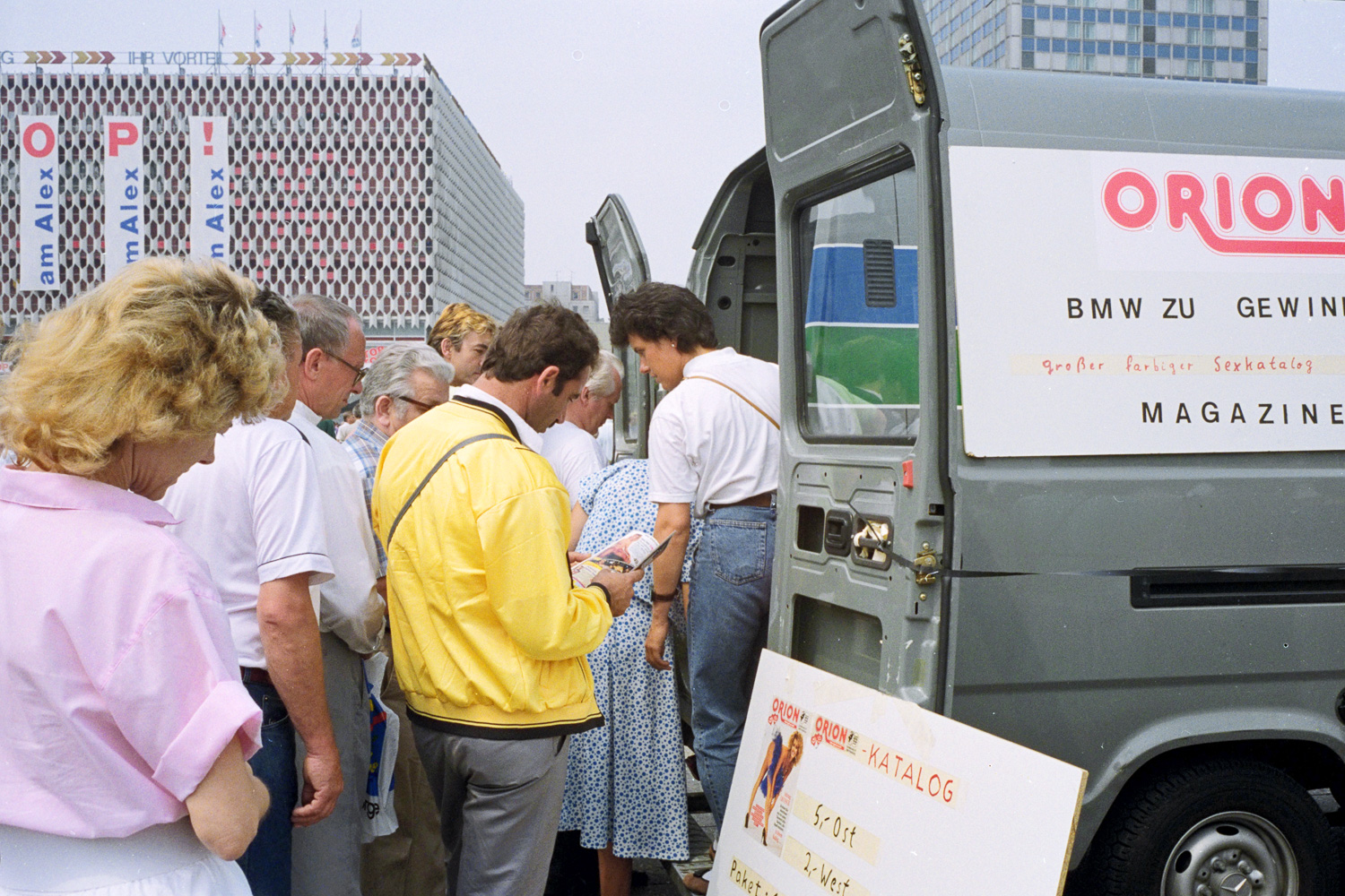 Alexanderplatz, East Berlin. Late June 1990. Pornography sales out of the back of a van.