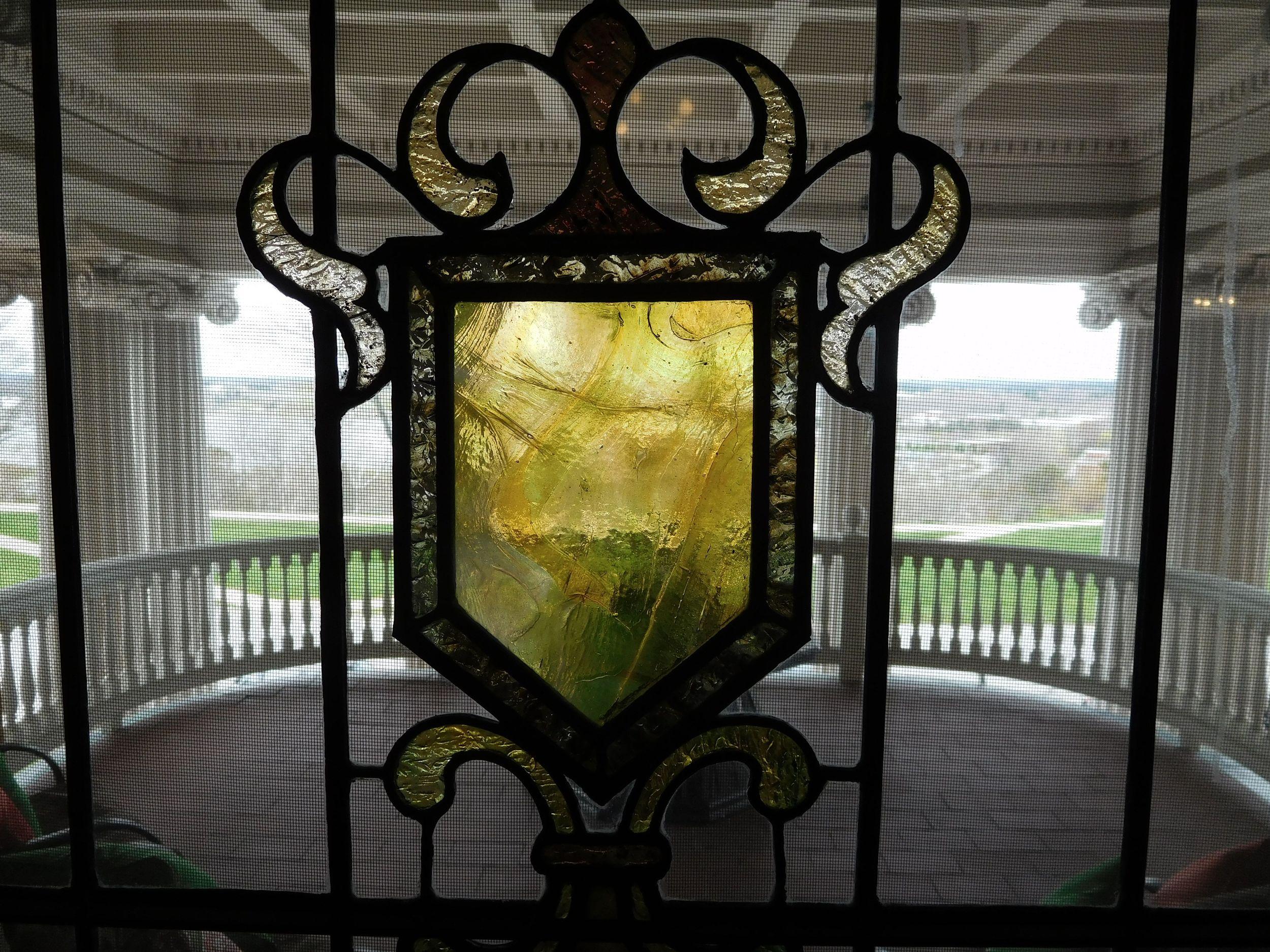 West Mansion promenade view thru 2nd floor stained glass.jpg