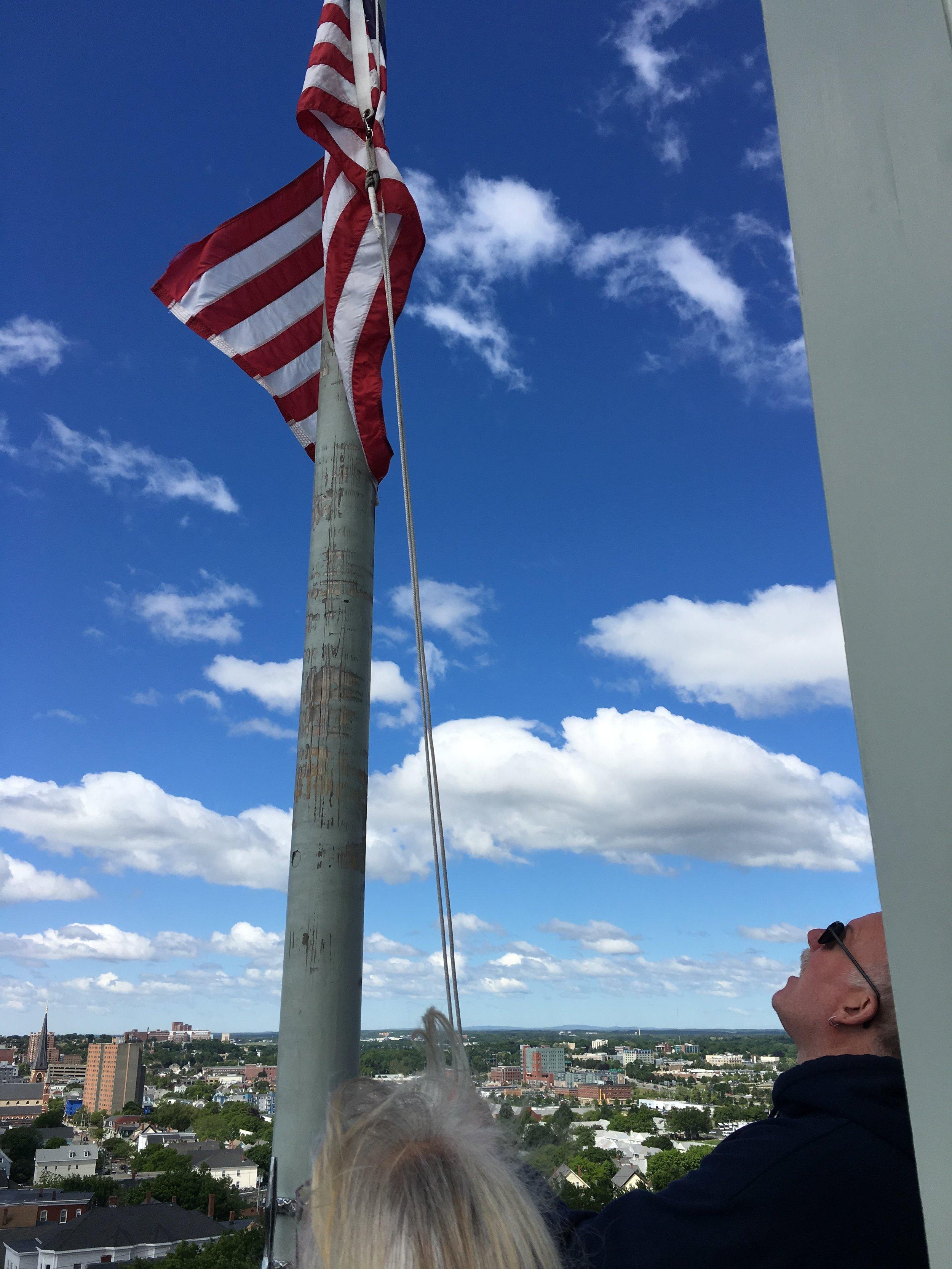 Flag raised by volunteer and Lemuel Moody descendent, John York.