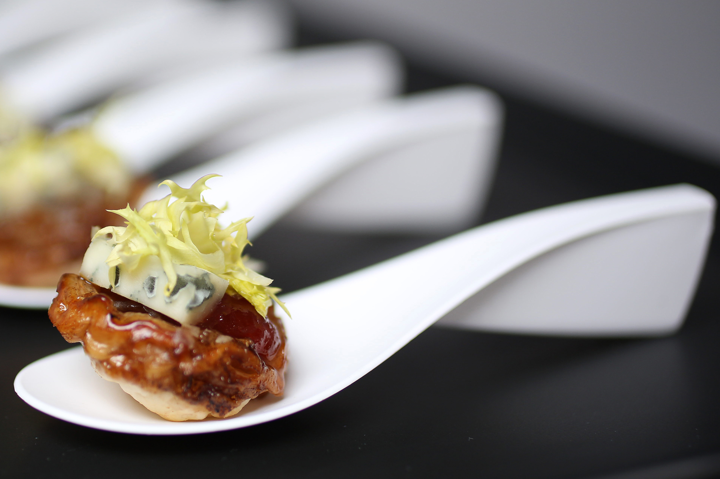 onion and fennel tart tatin with spicy tomato chutney and frisee salad web.jpg