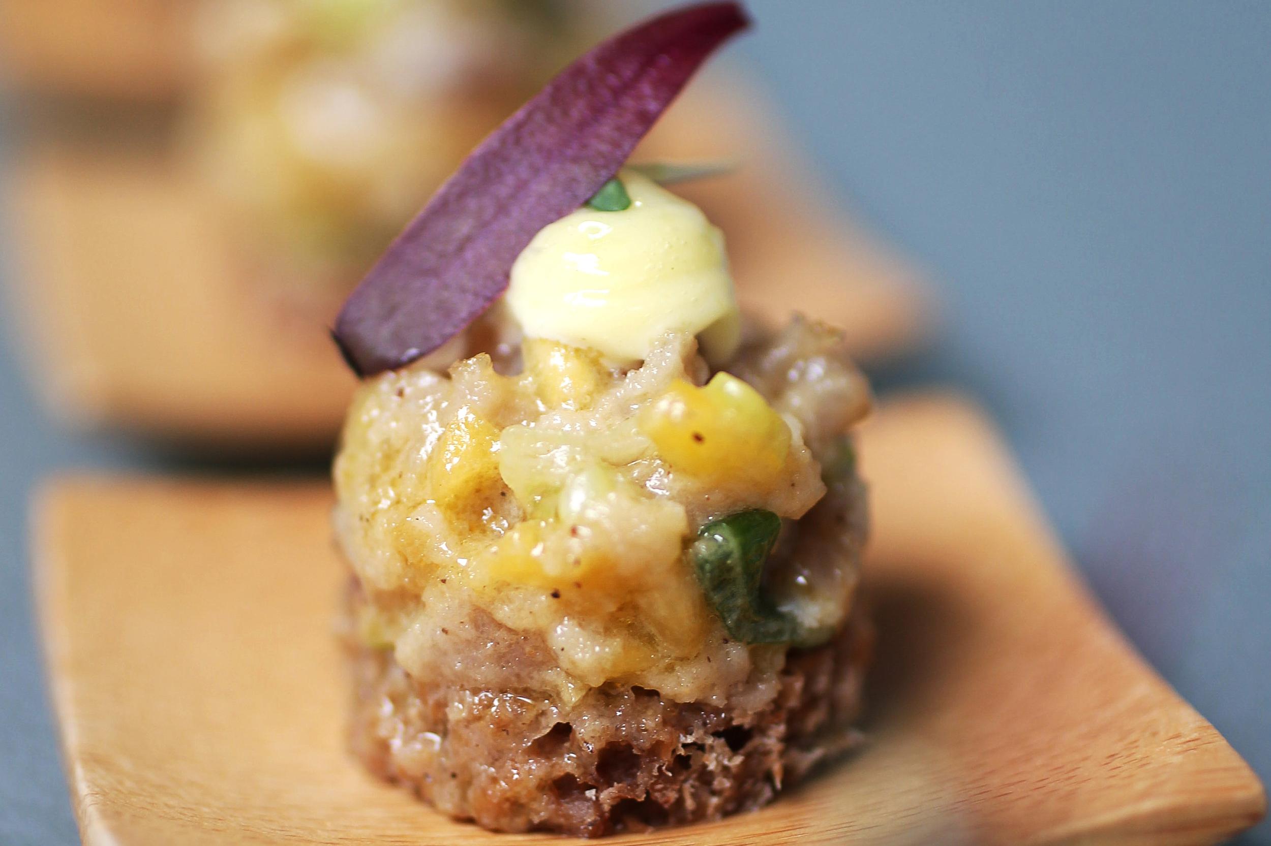 tuna tartar with spring onion, mango and wasabi mayonnaise served on pumpernickel bread web.jpg