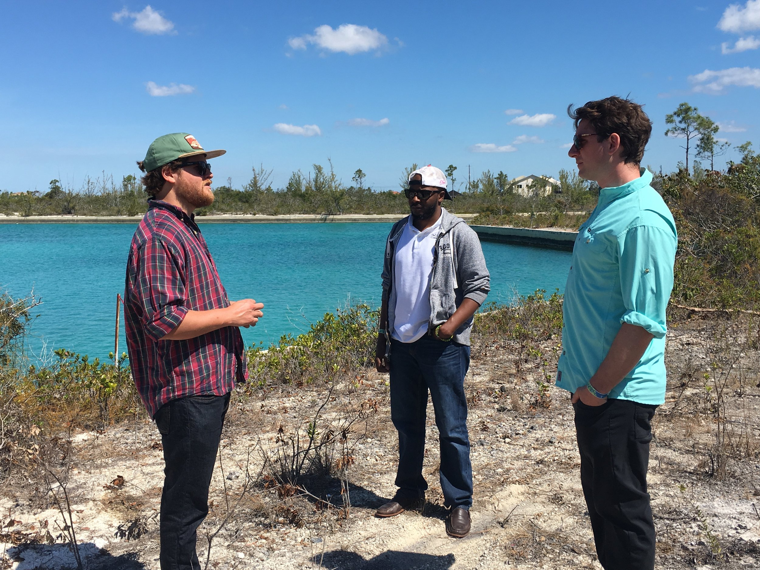 Gator sharing visions of global-scale reef restoration with the The Nature Conservancy team, starting here at the farm site in Grand Bahama.