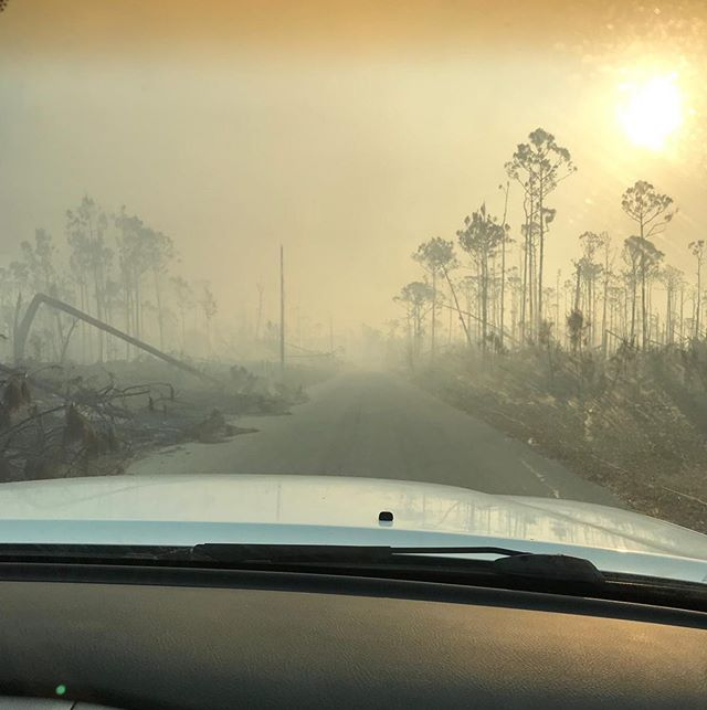 A new problem in #GrandBahama: forest fires. . After the biblical #HurricaneDorian storm surge inundated most of the island with saltwater, there's widespread vegetation mortality. With ironically a limited amount of rain since the storm, things are dry here. . What economical solutions do you have for clearing dead Caribbean pine wood? Any ideas @yalefes? We're thinking if nothing else, turn lots of it into mulch, and help give locals of the #Bahamas fresh soil (which originally was in short supply) to start growing their own food. . 📸: @hopssla
